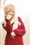 Portrait of pretty smiling woman in fur winter hat Royalty Free Stock Photos
