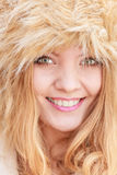 Portrait of pretty smiling woman in fur winter hat Royalty Free Stock Images