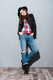 Portrait of pretty smiling woman in hat and leather jacket Royalty Free Stock Photo