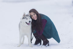 Portrait of Pretty Smiling Woman Hugging Her Husky Dog Outside Royalty Free Stock Photo
