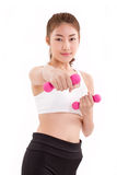 Portrait of pretty sporty girl, hand holding dumbbell, weight tr Royalty Free Stock Images
