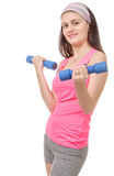 Portrait of pretty sporty girl holding weights Stock Photography