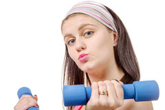 Portrait of pretty sporty girl holding weights Stock Image