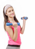 Portrait of pretty sporty girl holding weights isolated on white Royalty Free Stock Photography