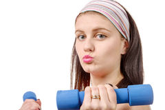 Portrait of pretty sporty girl holding weights isolated on white Stock Image