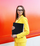 Portrait of pretty stylish woman in glasses, yellow suit Royalty Free Stock Images
