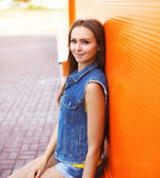 Portrait of pretty stylish young girl wearing a jeans clothes Stock Photos