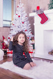 Portrait of pretty sweet little girl near a fireplace in Christmas. Portrait of pretty little girl near a fireplace in Christmas stock photography