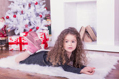 Portrait of pretty sweet little girl near a fireplace in Christmas. Portrait of pretty little girl near a fireplace in Christmas stock image