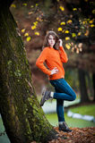 Portrait of pretty teen girl in autumn park Stock Photo