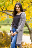 Portrait of pretty teen girl in autumn park royalty free stock photography