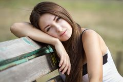 Portrait of pretty teen girl on a bench Stock Photo