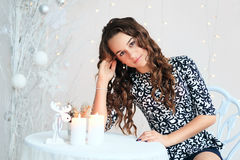 Portrait of a pretty teen girl with flowing long curly hair. In interior with Christmas decorations Stock Photography