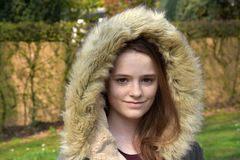 Cute teenage girl with winter jacket royalty free stock photography