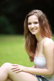 Portrait of a pretty teenage girl in a lush park Royalty Free Stock Photography