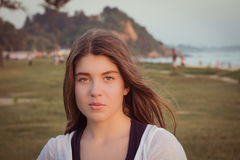 Portrait of a pretty teenage girl outdoor. At sunset. Toned effect Royalty Free Stock Image