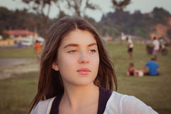 Portrait of a pretty teenage girl outdoor. At sunset. Toned effect Royalty Free Stock Photos