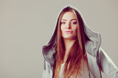Portrait of pretty teenager girl in hood. Royalty Free Stock Photo