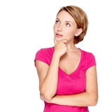 Portrait of the pretty thinking woman on white Stock Photography