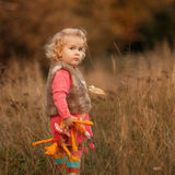 Portrait of pretty thoughtful girl in autumn park Stock Image