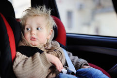 Portrait of pretty toddler boy sitting in car seat Royalty Free Stock Photography