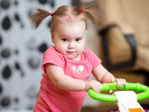 Portrait of pretty child girl standing with baby walker royalty free stock photo