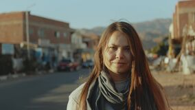Portrait of pretty tourist woman standing on the street at city Dahab background, Egypt, Sinai, 4k