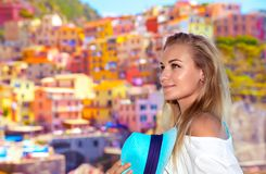 Pretty traveler girl. Portrait of a pretty traveler girl enjoying amazing view on a many colorful houses, active summer vacation, enjoying trip to Cinque Terre Royalty Free Stock Photos