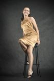 Portrait of pretty woman. On the chair Royalty Free Stock Image