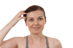 Portrait of a pretty woman. Arranging her hair Royalty Free Stock Images