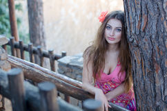 Portrait of pretty woman attached flower in her hair Royalty Free Stock Image