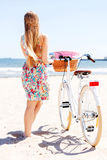 Portrait of a pretty woman with bicycle Stock Photos