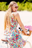 Portrait of a pretty woman on bicycle in the park Royalty Free Stock Image