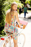 Portrait of a pretty woman on bicycle in the park Stock Image