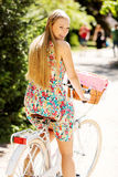 Portrait of a pretty woman on bicycle in the park Royalty Free Stock Photo