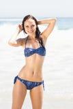 Portrait of pretty woman in bikini standing on the beach Royalty Free Stock Photos