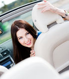 Portrait of pretty woman in the cabriolet Stock Photography
