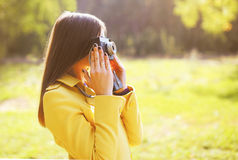 Portrait pretty woman with camera Stock Images