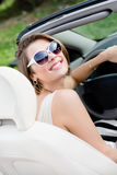 Portrait of pretty woman in the car Stock Image
