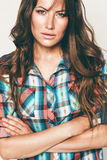 Portrait of pretty woman in check shirt Royalty Free Stock Images