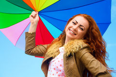 Portrait of a pretty woman with colorful umbrella Stock Photography