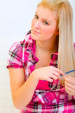 Portrait of pretty woman combing hair Royalty Free Stock Photography