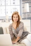 Portrait of pretty woman with computer Royalty Free Stock Photos