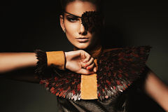 Portrait of pretty woman with creative eyepatch. In dark Royalty Free Stock Image