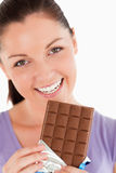 Portrait of a pretty woman eating chocolate Royalty Free Stock Images