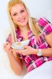 Portrait of pretty woman eating muesli Stock Photography