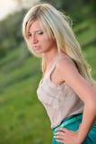 Portrait of a pretty woman in the field Stock Photo