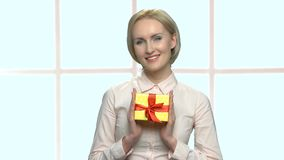 Portrait of pretty woman with gift box. stock video