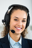 Portrait of pretty woman with headset Royalty Free Stock Photography