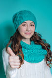 Portrait of a pretty woman in a knitted hat and scarf in studio Royalty Free Stock Image